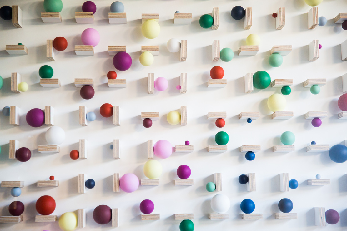 colorful art piece balls of colour on wooden blocks