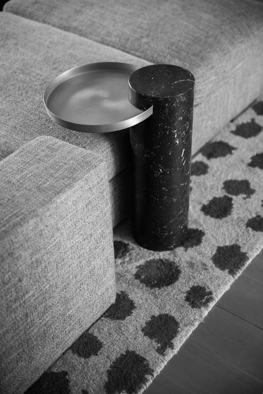 Lachance low side table on a grey rug with black spot