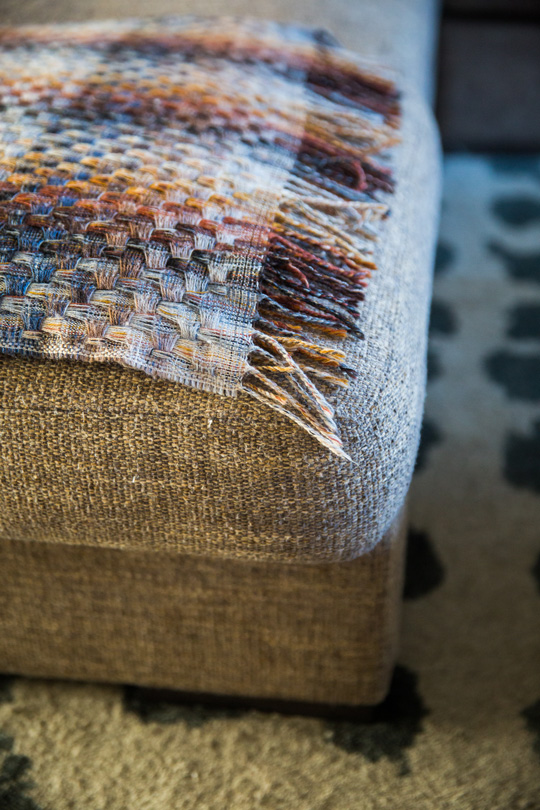 Cocooning athmosphere, Missoni home plaid with winter colours on a grey sofa