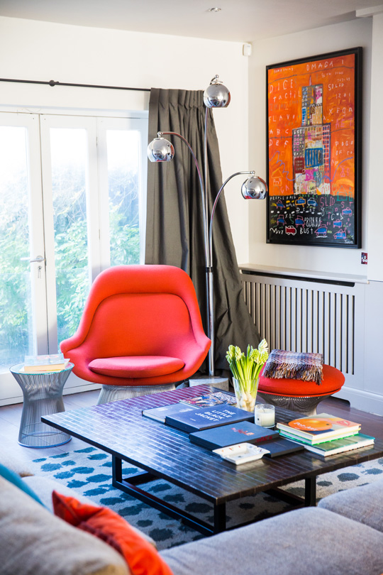 Contemporary low table with vintage floor lamp and warren platner red chair