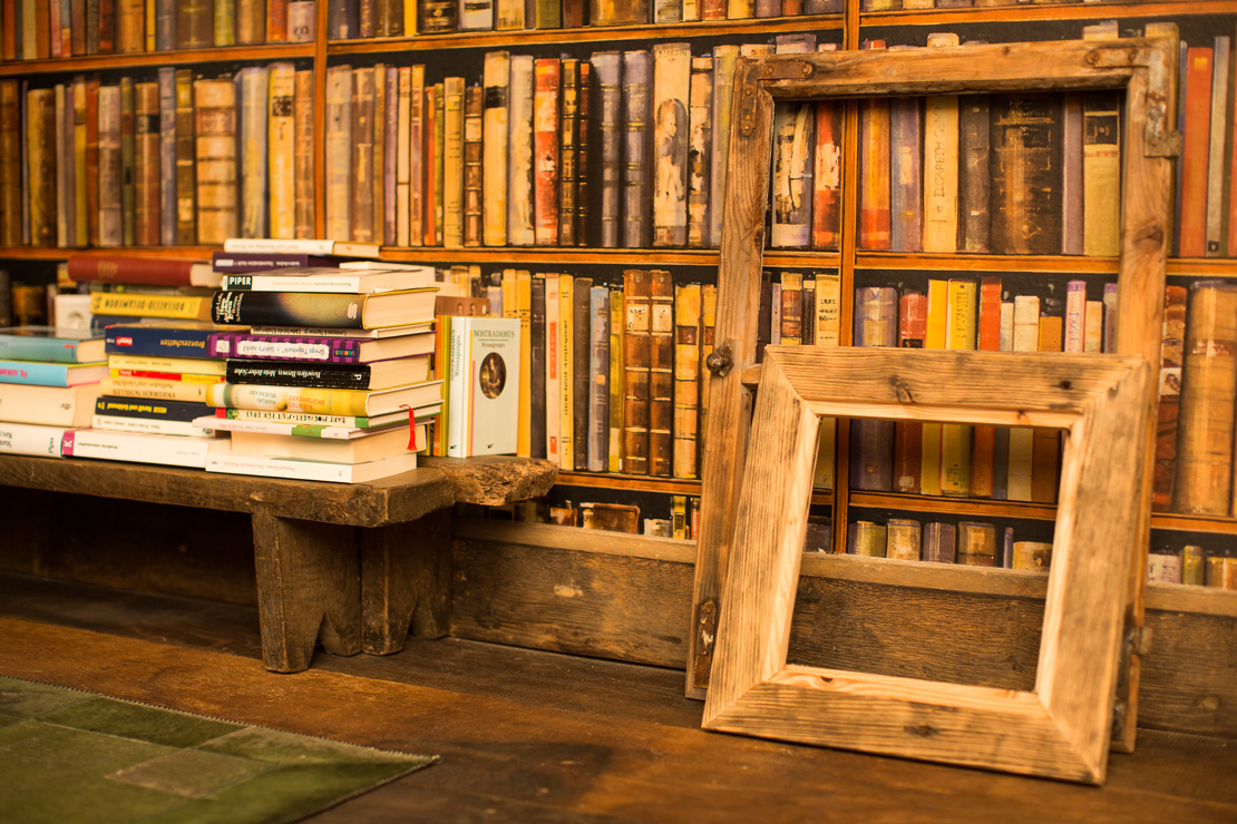 rustic library wallpaper with books from andrew martin