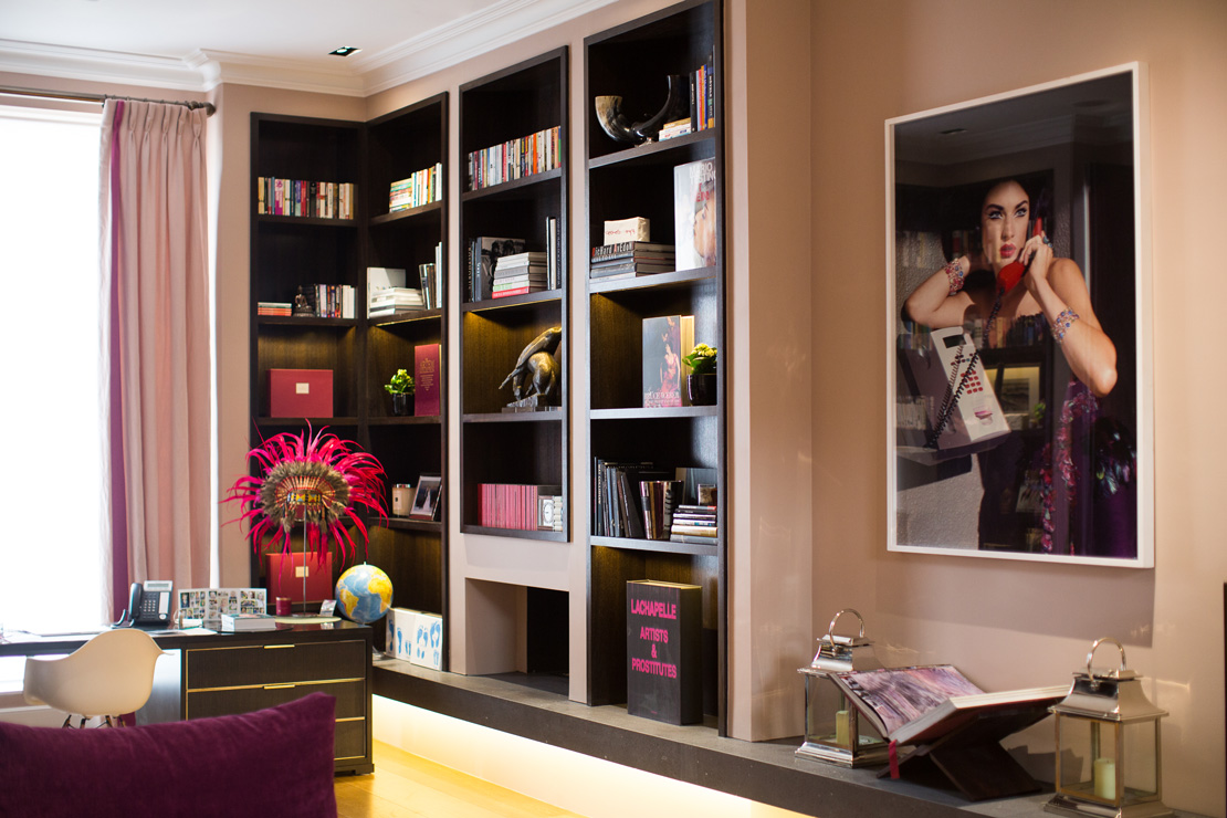 audacious and modern black and pink library with an indian headdress