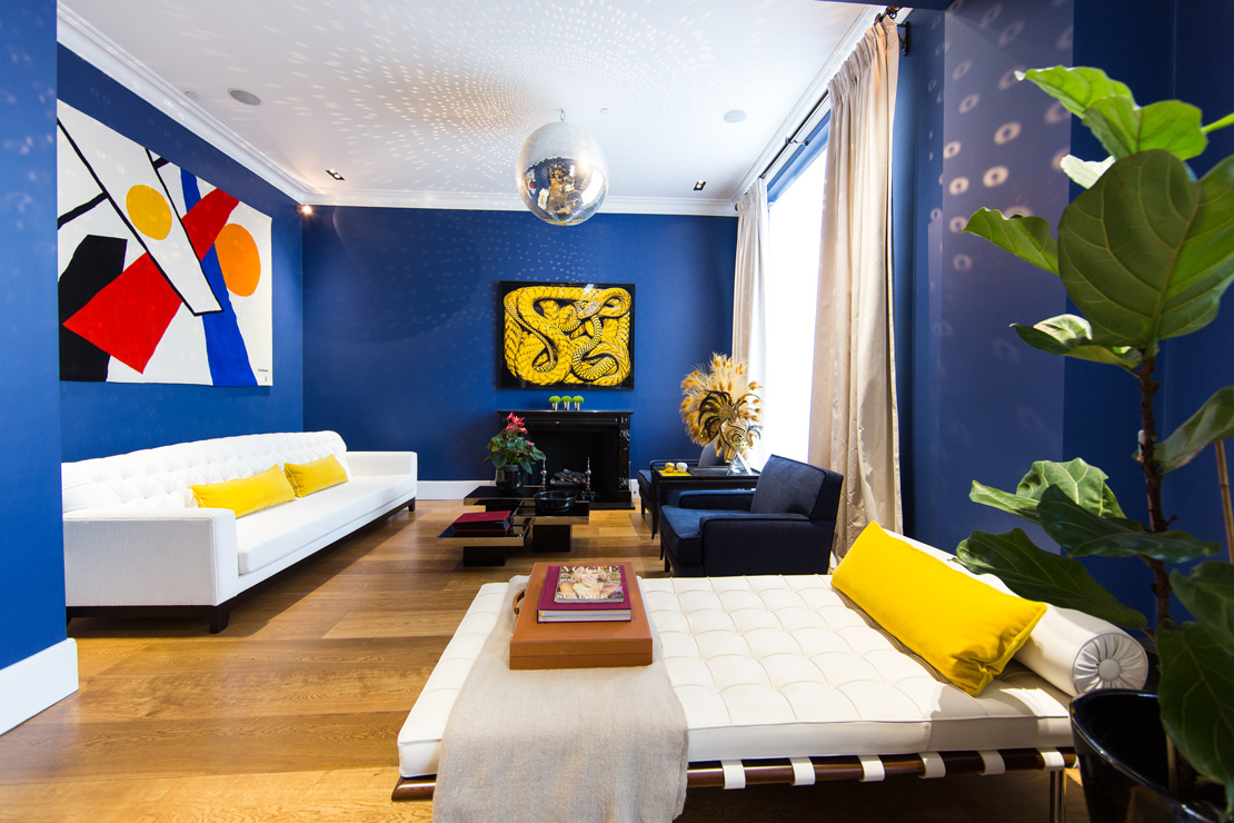 Modern contemporary deep blue and yellow livingroom with a Calder Tapestry