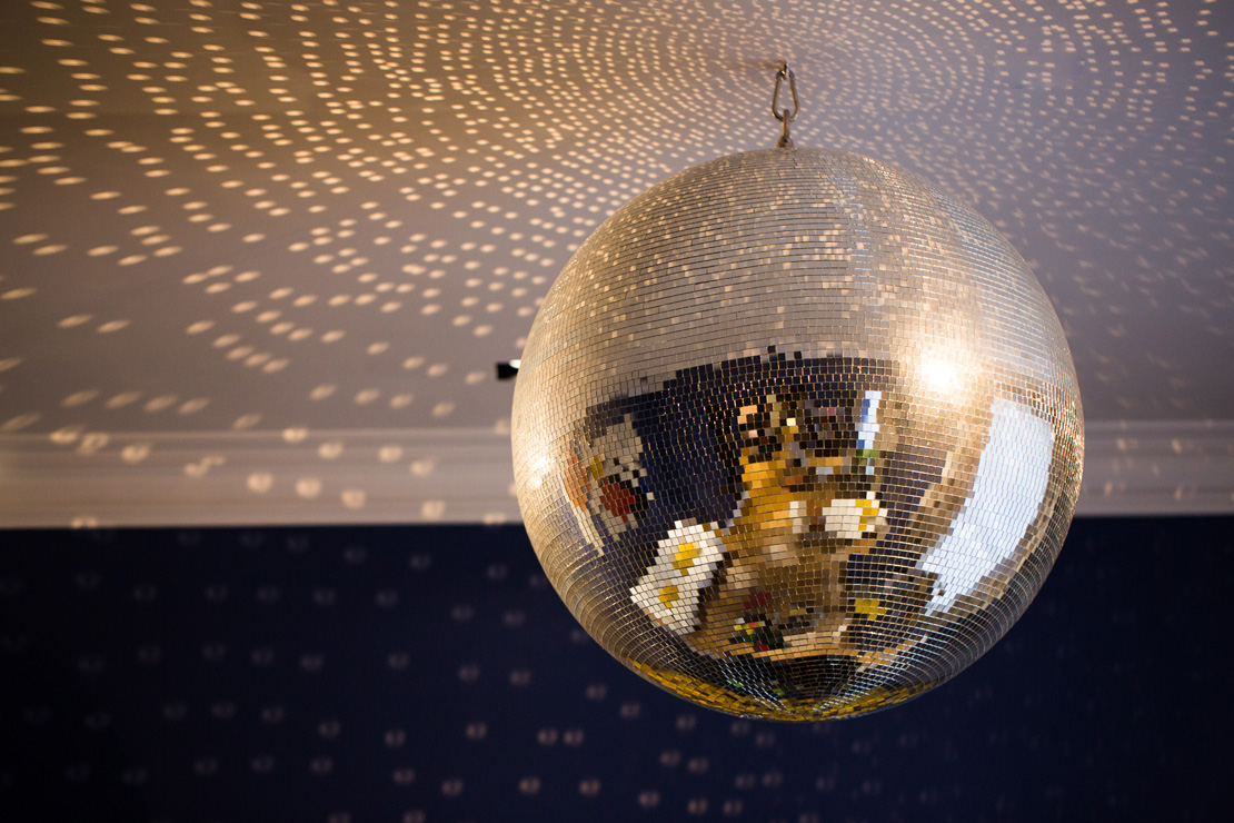 Vintage Disco mirror ball hanging in a contemporary living room in a London Townhouse