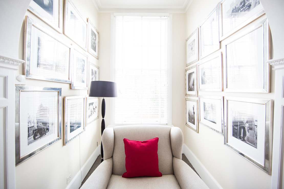 Cosy Armchair in a narrow room plenty of frames with picturesCosy Armchair in a narrow room plenty of frames with pictures