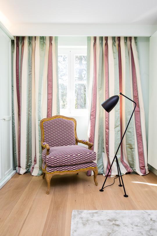 Manuel Canovas armchair with modern contemporary floor lamp
