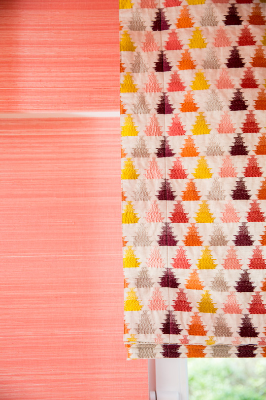 Coral straw wallpaper with colourful embroidered triangles