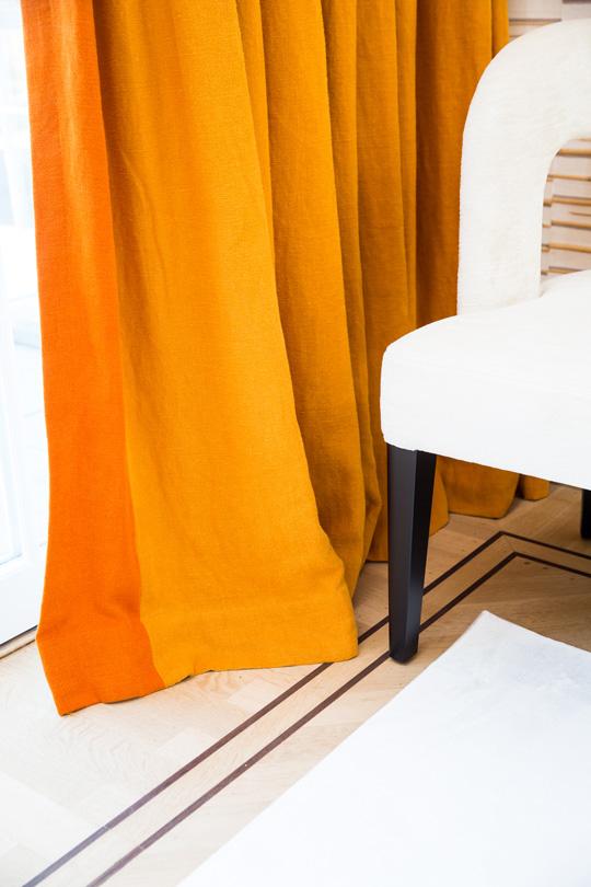 Linen orange curtain with white velvet woodenbench