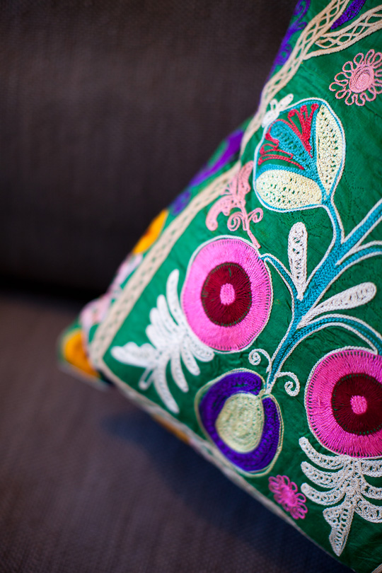 Embroidered red pink and purple cushions