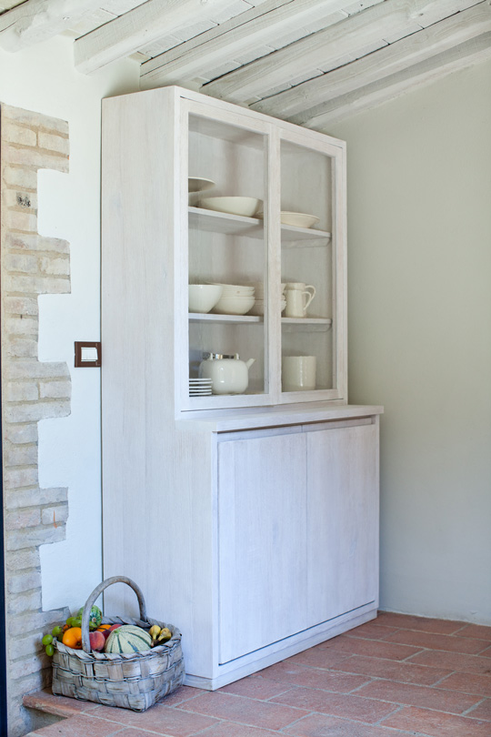 White wooden contemporary dresser  in a family house in Tuscany