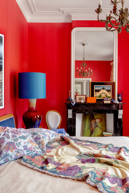 red bedroom in a castle with ceramic side lamp by the interior designer Victoria Maria