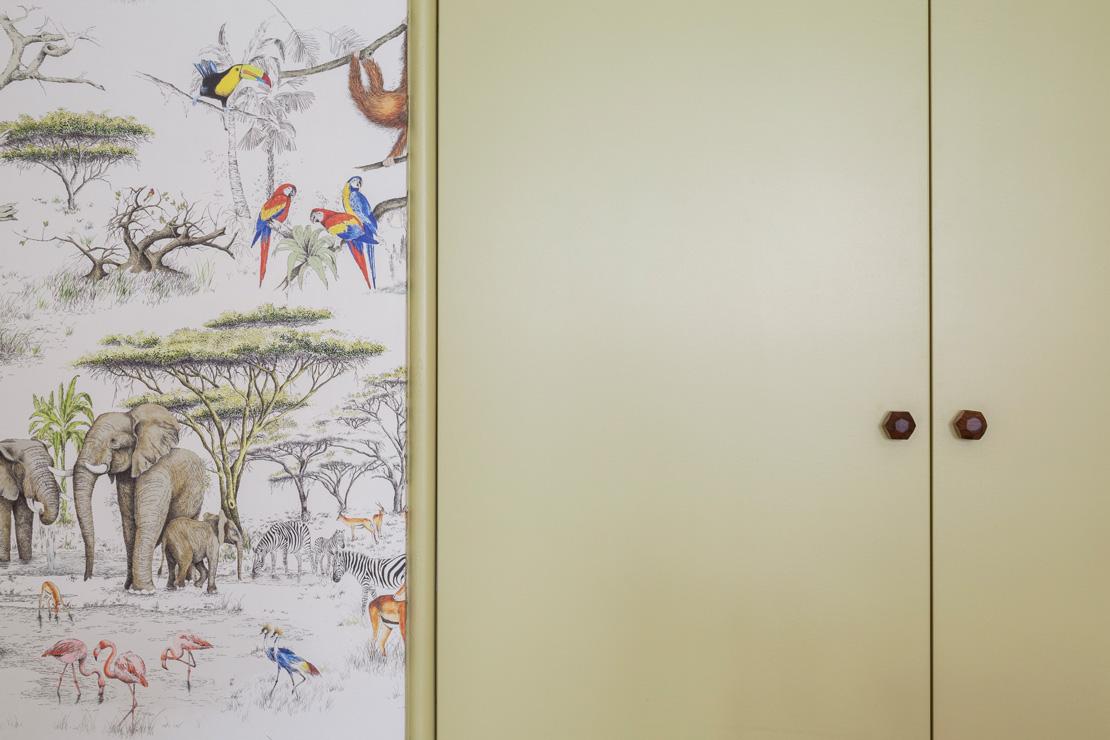 Jungle wallpaper from la maison pierre frey in a kids bedroom with a light green cupboard