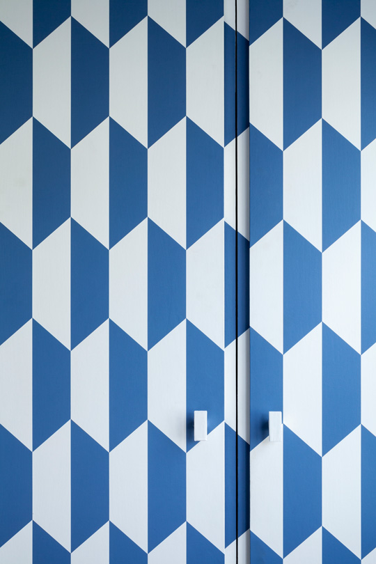 Cole and sons blue and white wallpaper on a wardrobe